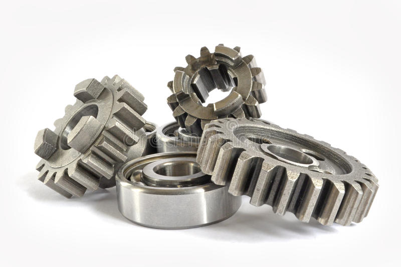 Gears and bearings. On the white background royalty free stock photo