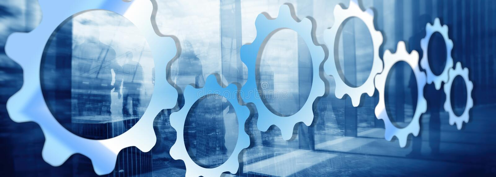 Gears on a blue background. Mixed media Technology background. royalty free stock photos