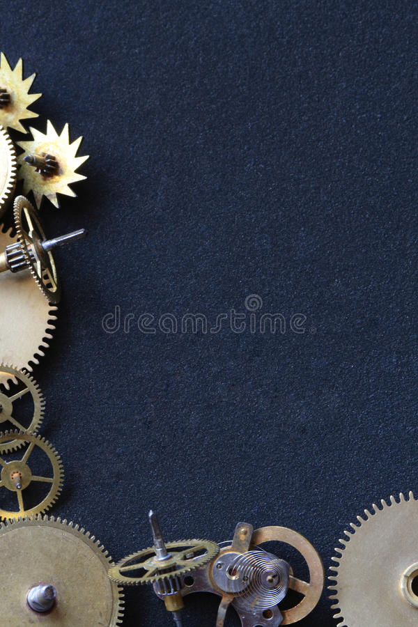 Gears Border. Border made from old assorted gearwheels isolated on dark background with copy space stock photo
