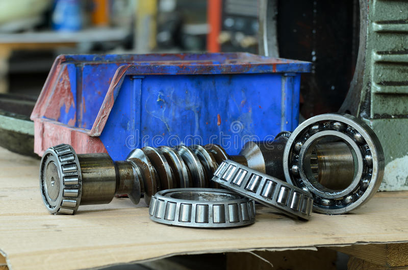 Gears box and bearings. Close-up- of gears box and bearings disassembled for repair equipment industry service station stock photo