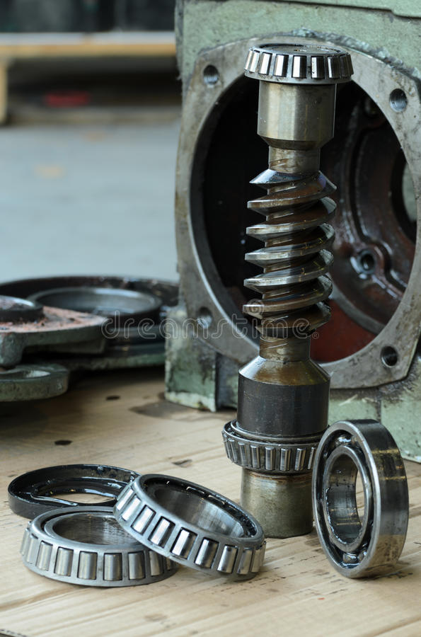 Gears box and bearings. Close-up- of gears box and bearings disassembled for repair equipment industry service station stock images