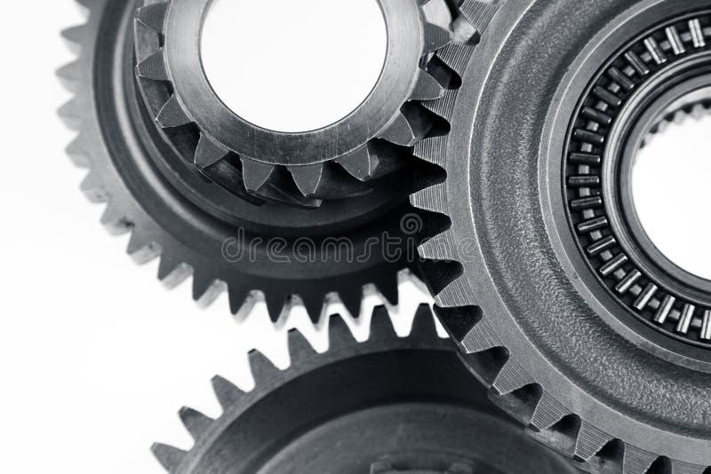Gears. Closeup of three metal cog gears stock image