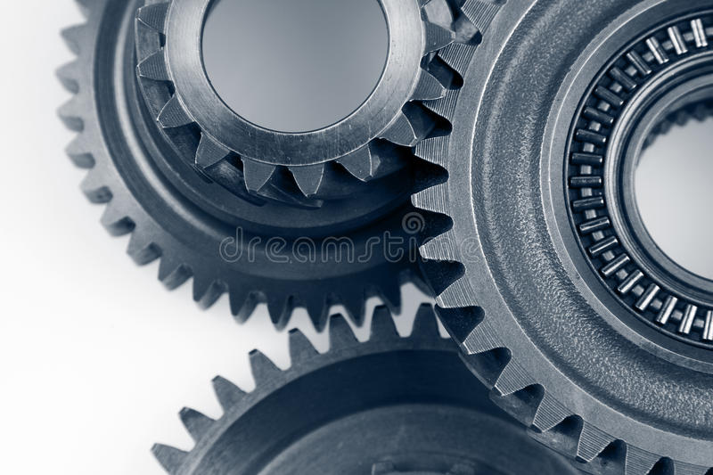 Gears. Closeup of three metal cog gears royalty free stock images