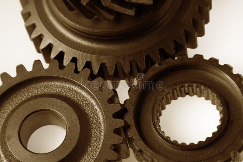 Gears. Closeup of three steel gears stock photos