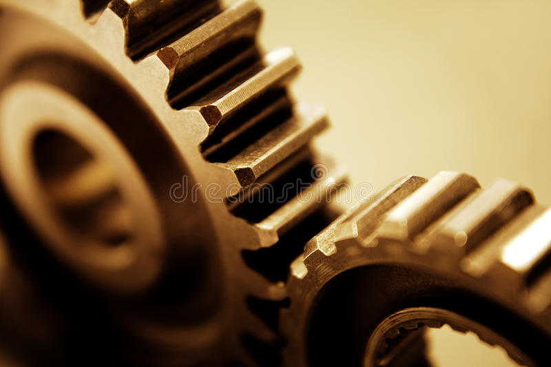 Gears. Closeup of two metal cog gears stock photography