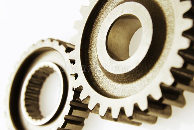Gears. Closeup of two metal cog gears stock photos