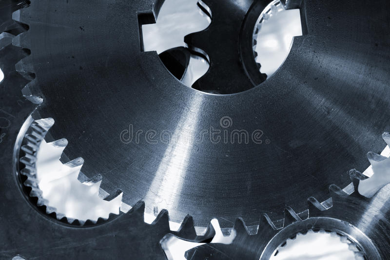 Gears and cogwheel machinery. Titanium and steel, blue toning idea royalty free stock photo