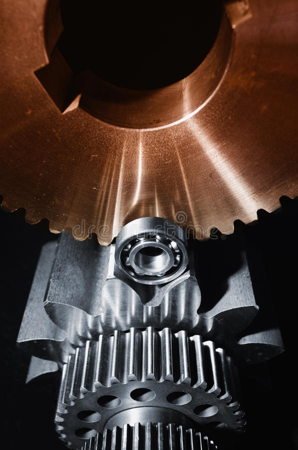 Gears and cogwheels set against black blackround. Aerospace gears and cogs set against a black velvet background, dual color concept royalty free stock image