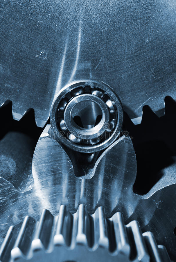 Gears and cogwheels set against black blackround. Aerospace gears and cogs set against a black velvet. close-ups concept stock photo