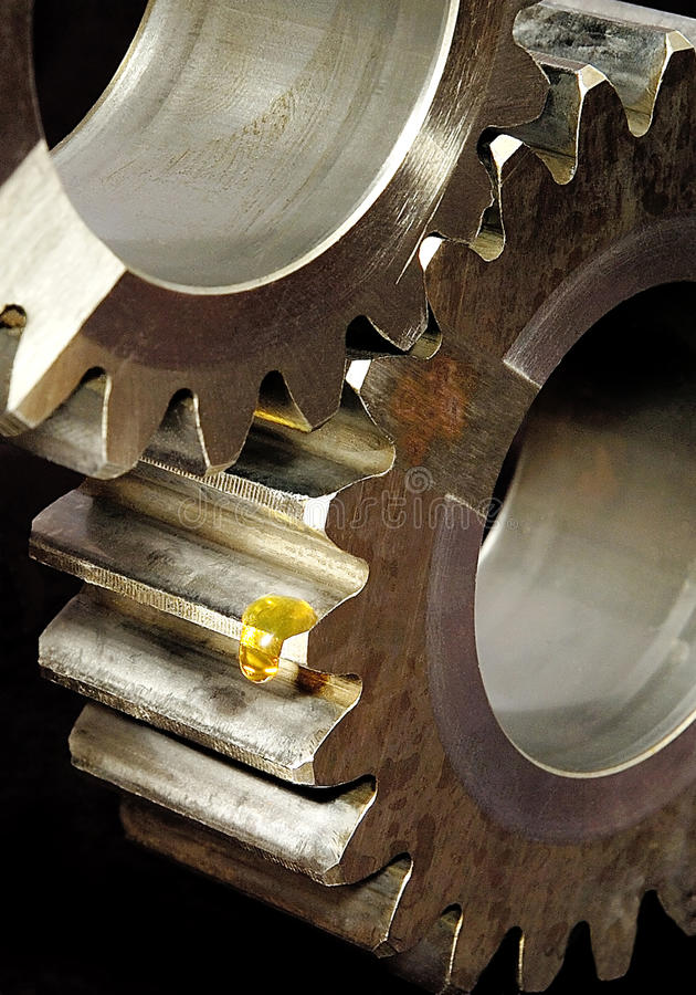 Gears and a drop of oil stock images