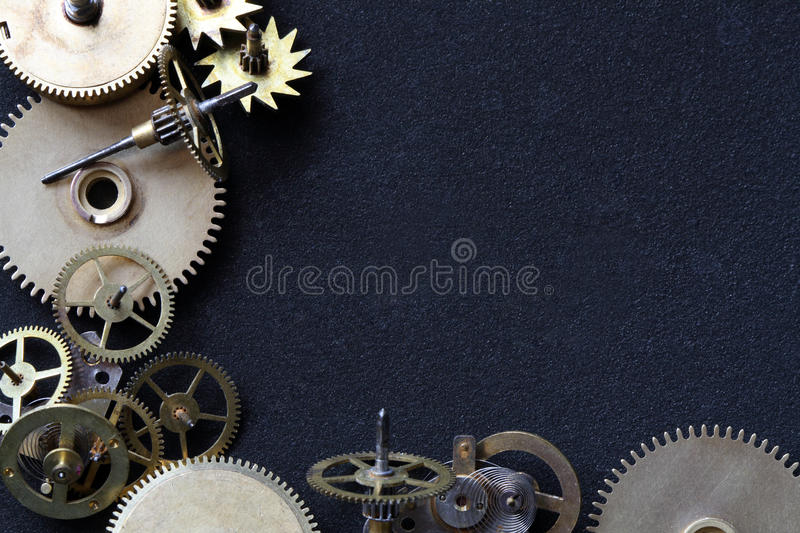 Gears Frame. Old assorted gearwheels isolated on dark background with copy space royalty free stock photos