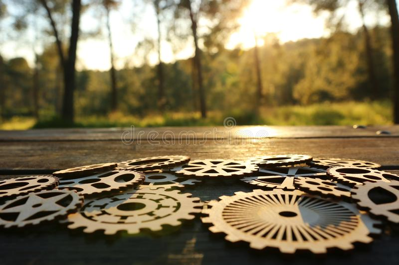 gears in front of a setting sun. Concept of a new idea, learning and creative though stock images