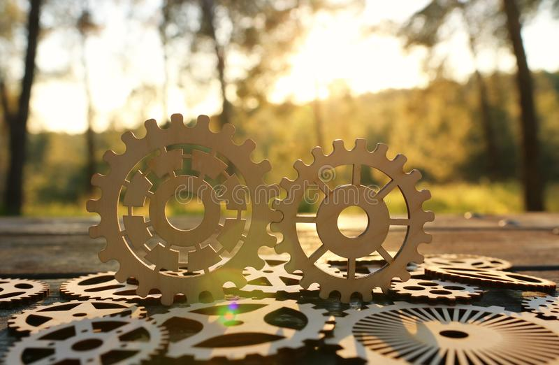 Gears in front of a setting sun. Concept of a new idea, learning and creative though. Wheel industry business cogwheel engineering technology industrial work royalty free stock photography