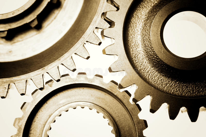 Gears. Metal cog gears joining together stock images