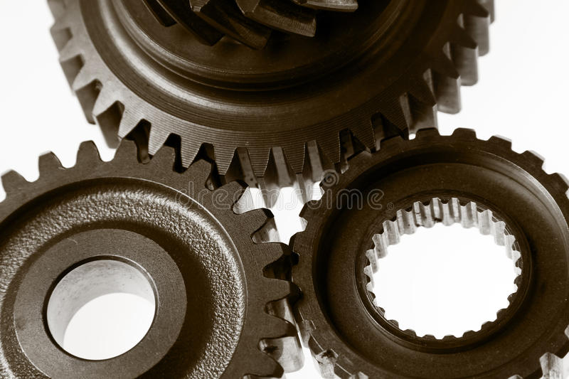 Gears. Metal cog gears joining together royalty free stock images