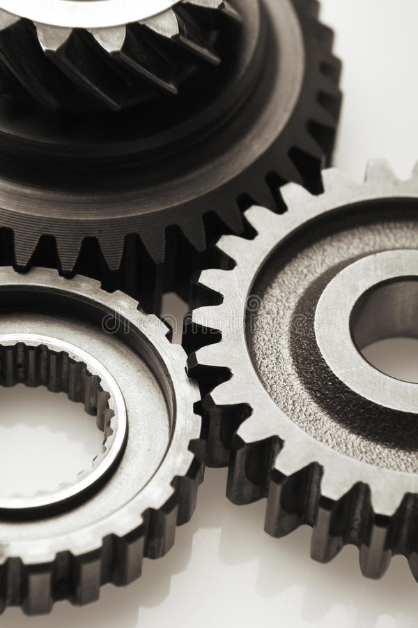 Gears. Metal cog gears joining together stock photography