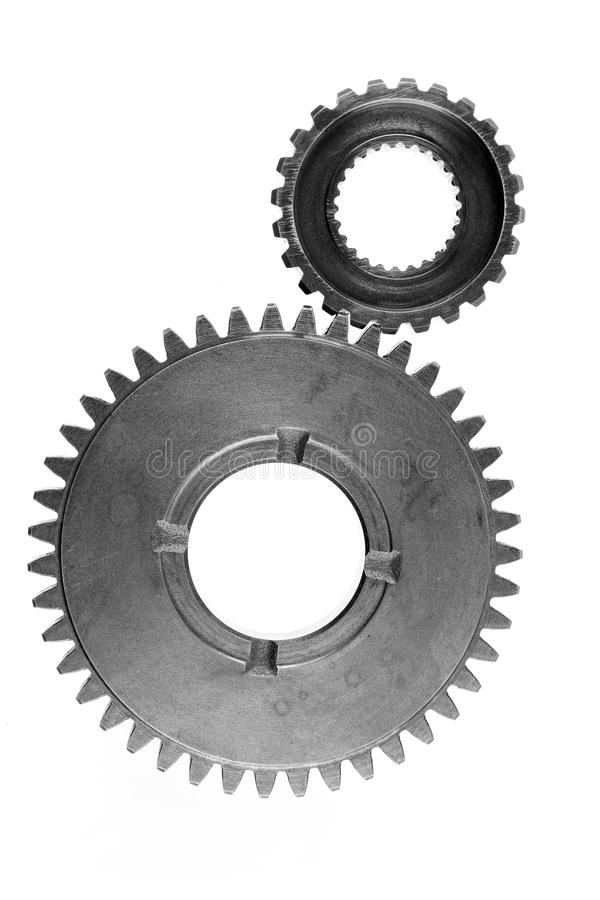 Gears. Metal gears on plain background royalty free stock photo