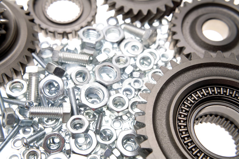 Gears, nuts and bolts. Closeup stock photo