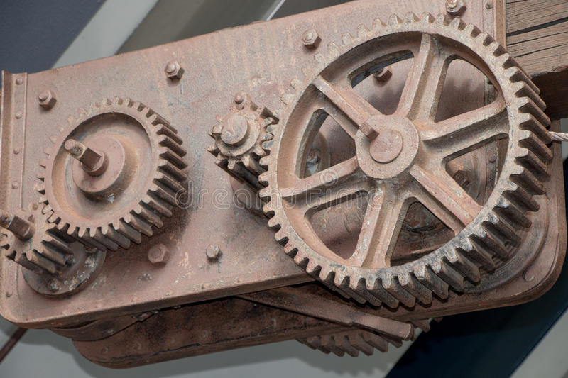 Industrial steel gears and cogs. Rusting on wharf royalty free stock image