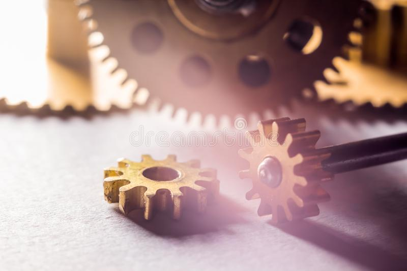 Gears from old watches, an example for studying ways of transfer stock image
