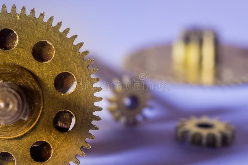 Gears from old watches, an example for studying ways of transfer stock photos