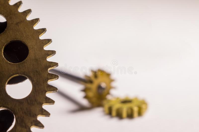 Gears from old watches, an example for studying ways of transfer. Ring motion royalty free stock photo
