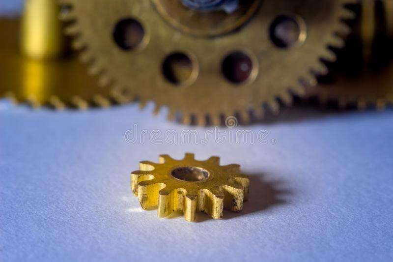 Gears from old watches, an example for studying ways of transfer stock images