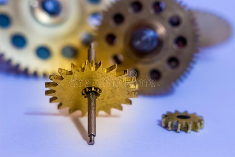 Gears from old watches, an example for studying ways of transfer. Ring motion stock images