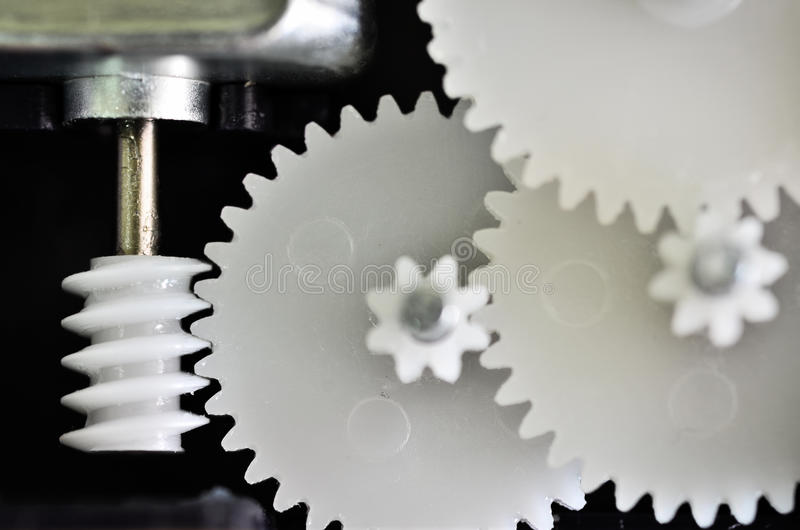 Gears rotating. Closeup circle of gears rotating by motor stock photo