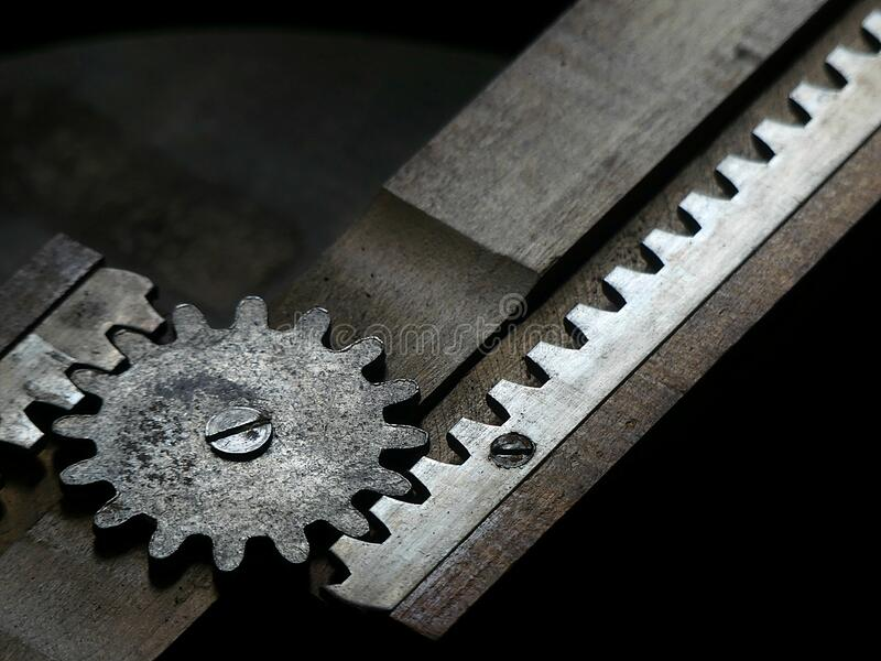 Gears from a 1920`s apartment dining table -  film noire style stock photography