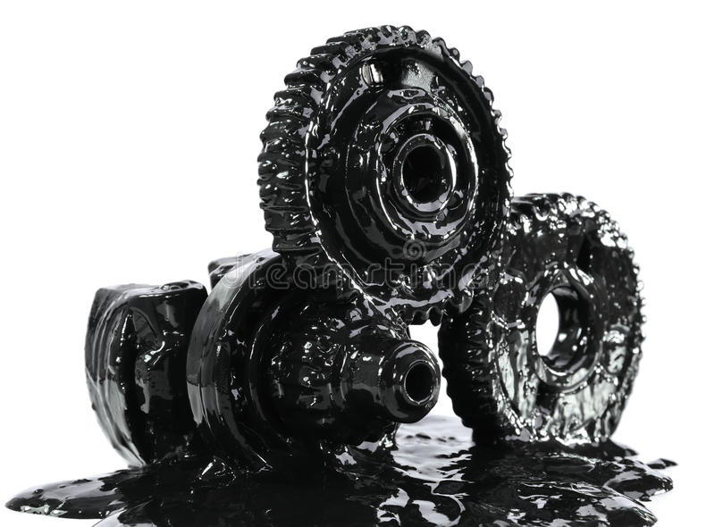 Gears soiled with black oil stock images