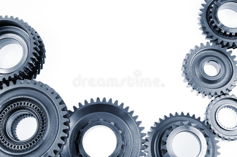 Gears. Steel cog gears on plain background. Copy space royalty free stock photo