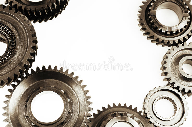 Gears. Steel cog gears on plain background. Copy space stock images