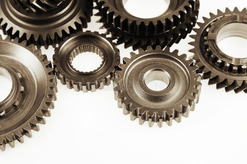 Gears. Steel cog gears on plain background. Copy space royalty free stock image