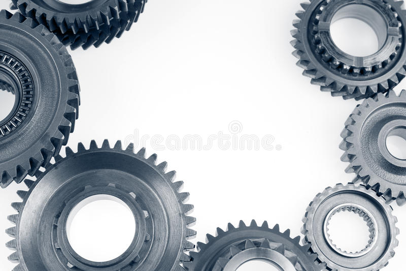 Gears. Steel cog gears on plain background. Copy space stock image