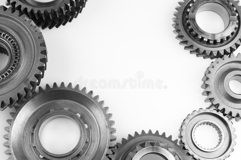 Gears. Steel cog gears on plain background. Copy space royalty free stock images