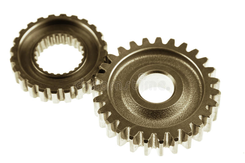 Gears. Two metal gears on plain background royalty free stock photo