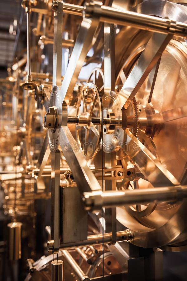 Gears of vintage clock mechanism. Gears of vintage world clock mechanism stock photography