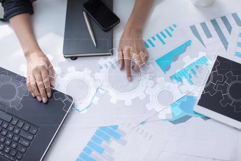 Gears on virtual screen. Business strategy and technology concept. Automation process. Gears on virtual screen. Business strategy and technology concept royalty free stock images