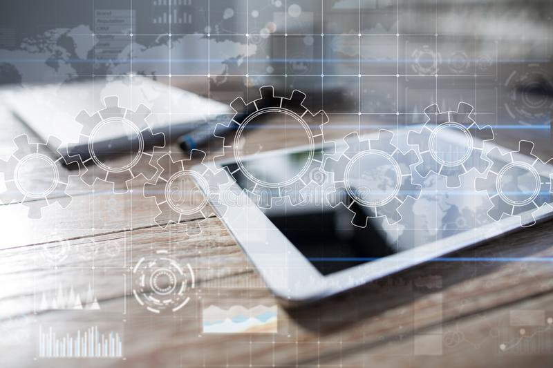 Gears on virtual screen. Business strategy and technology concept. Automation process. Gears on virtual screen. Business strategy and technology concept stock photo