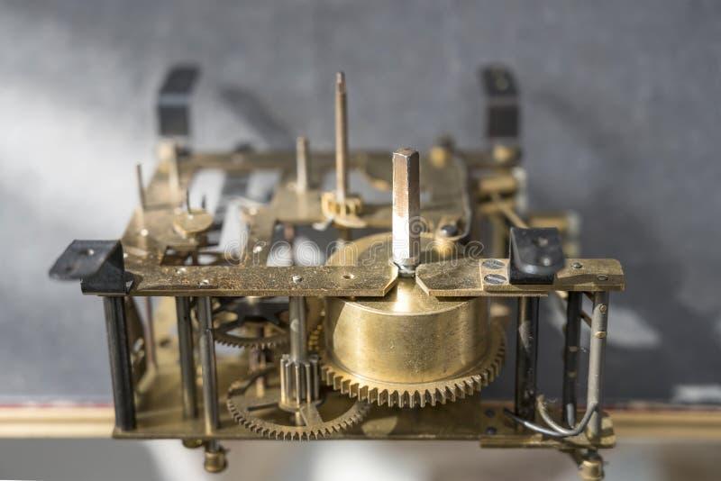 Gearwheels of clockwork mechanism. Detail of gearwheels of clockwork mechanism, shot at Milan, Italy stock photo
