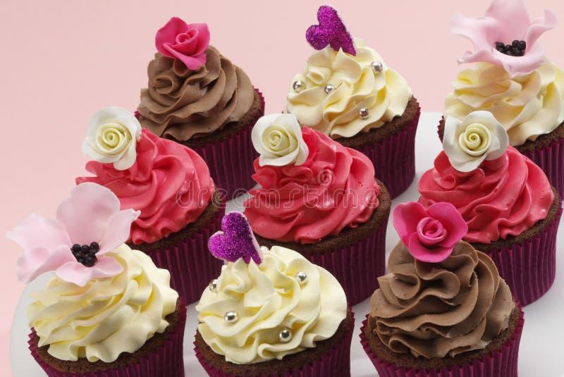 Geassorteerd cupcakes stock afbeeldingen