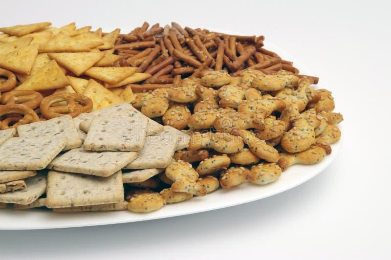 Geassorteerde snacks stock afbeeldingen
