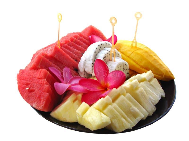 Geassorteerde tropische vruchten op een plaat stock fotografie