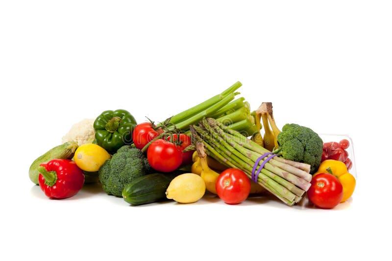 Geassorteerde vruchten en groenten op wit stock fotografie