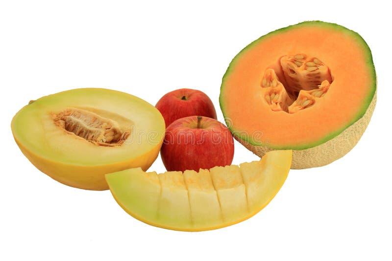 Geassorteerde vruchten - meloenen en appelen stock afbeeldingen