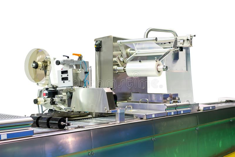 Geavanceerd technisch en modern nieuw automatisch voedsel of andere verpakking en etikettering machine met plastic filmrol voor i stock afbeeldingen