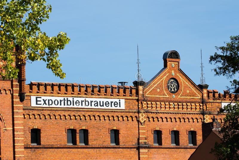 Gebäude mit Ziegelsteinmaurerarbeit - historische Brauerei stockbild