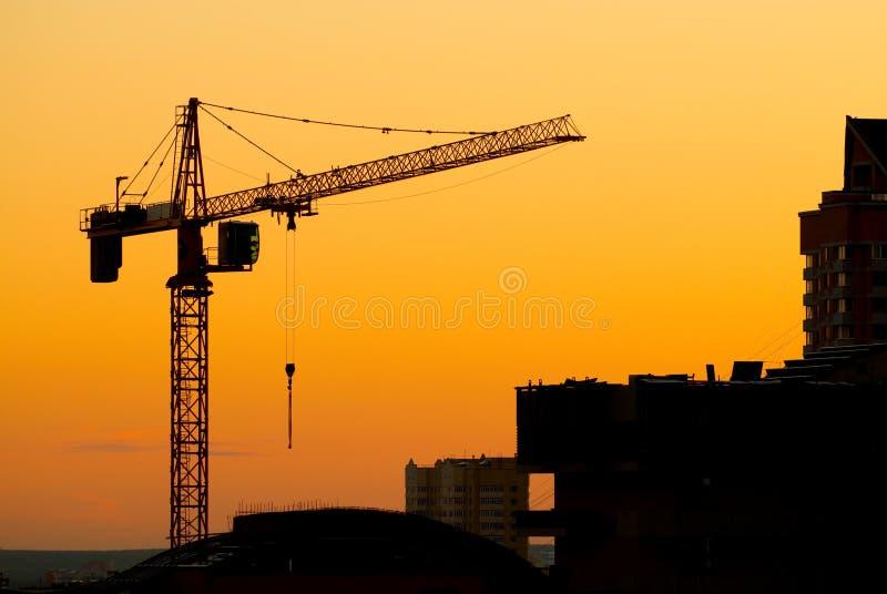 Gebäudekranschattenbilder stockbilder