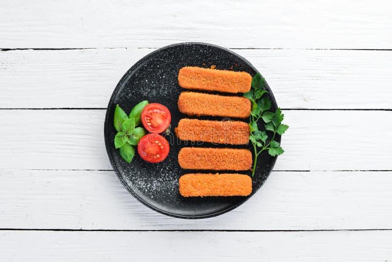 Gebackene Fisch-Stöcke stockfotografie